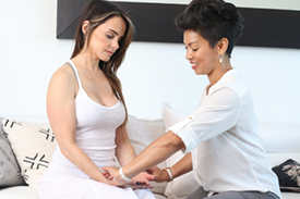 Female practitioner or doctor working a patient