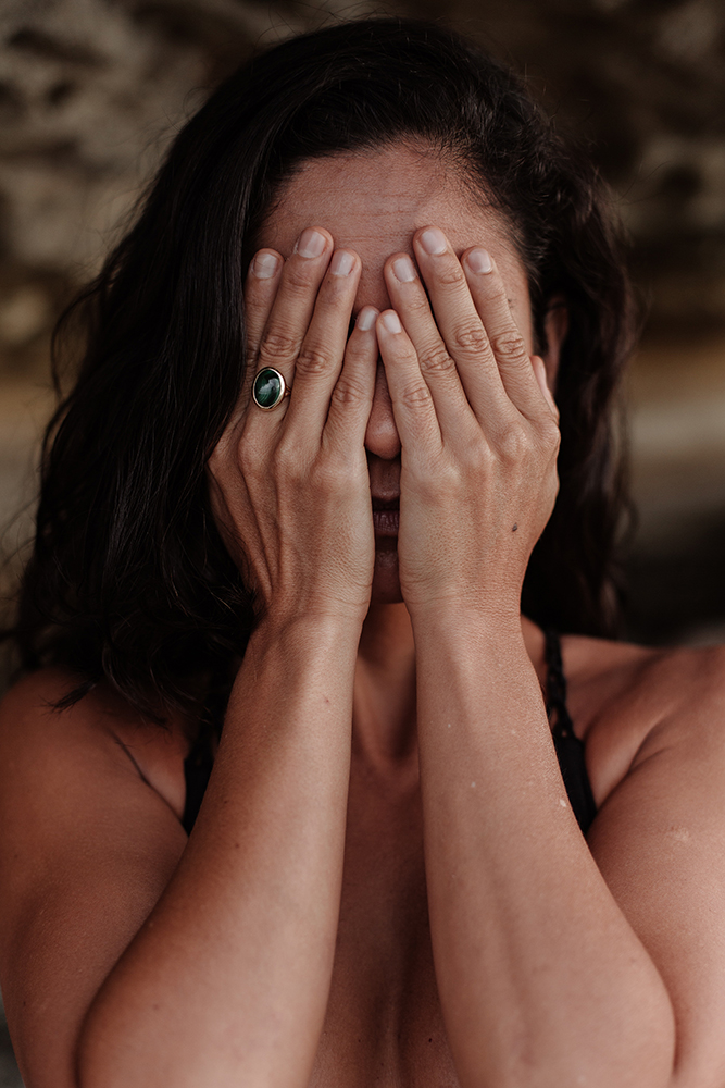 Photo of woman covering her face - stressed