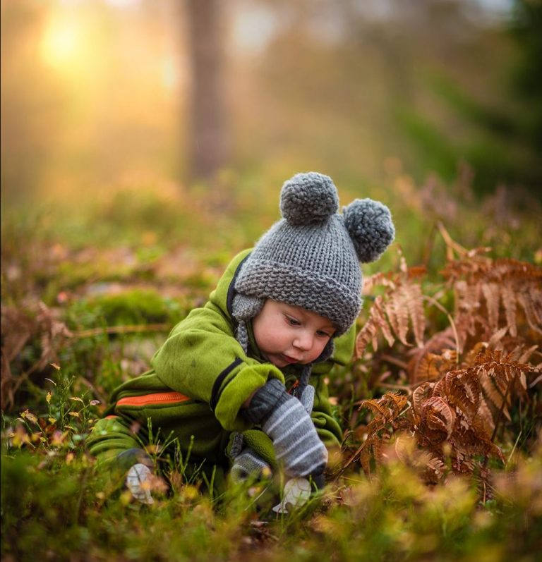 Baby/Toddler surrounded by Fall leaves/weather