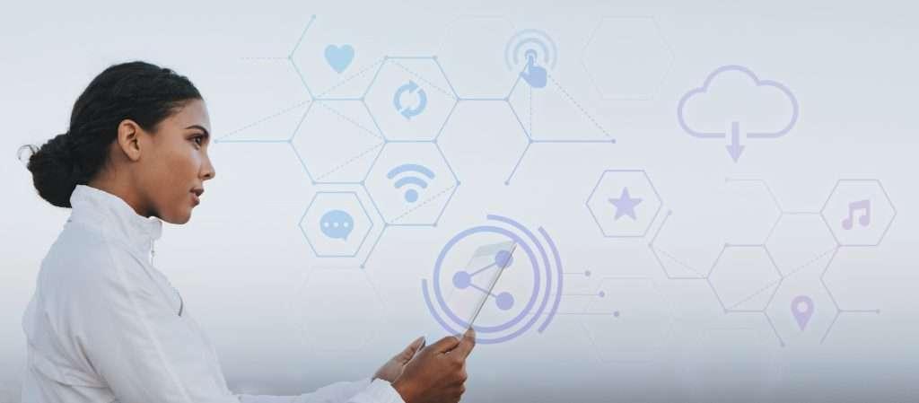 Hispanic woman using a digital tablet and looking at various social media / website icons