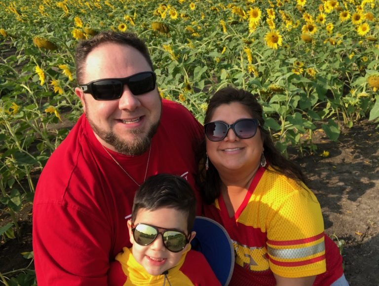 Marisa, Travis, and G at Grinter Farms for the Sunflower season - 9/2020