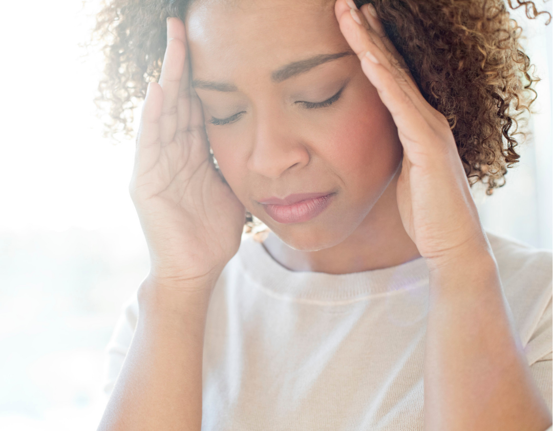 Migraine Pain effecting Black woman with bright light