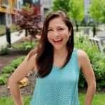 Claudia Alcantara happily standing in a garden